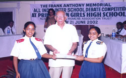 Ashritha Prasad and I. Soumya receive the Best Team Award for the All-India Frank Anthony Memorial Debate held at Hyderabad
