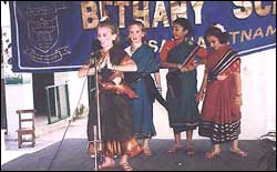 Children performing at a school function.